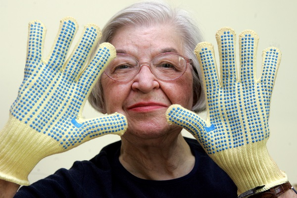 Stephanie Kwolek, 83, shown in this June 20, 2007 file photo taken in Brandywine Hundred, Del., she wears regular house gloves made with the Kevlar she invented. Her friend, Rita Vasta, told The Associated Press that Stephanie Kwolek died Wednesday in a Wilmington hospital. at age 90. (AP Photo/The News Journal, Jennifer Corbett)