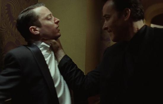 """Elijah Wood and John Cusack in """"Grand Piano"""" (2013)."""